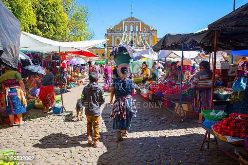 Santa Maria de Jesus, Guatemala -December 2018: Busy market in Santa maria de Jesus, a small indigenous village in the outskirt of Antigua. The market is in the town center in front of the church.
