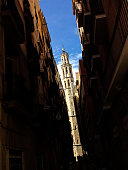 Barcelona, Spain - September 15, 2016: Santa Maria del Mar in the Gothic quarters of Barcelona. Giant church tower seen across the street.