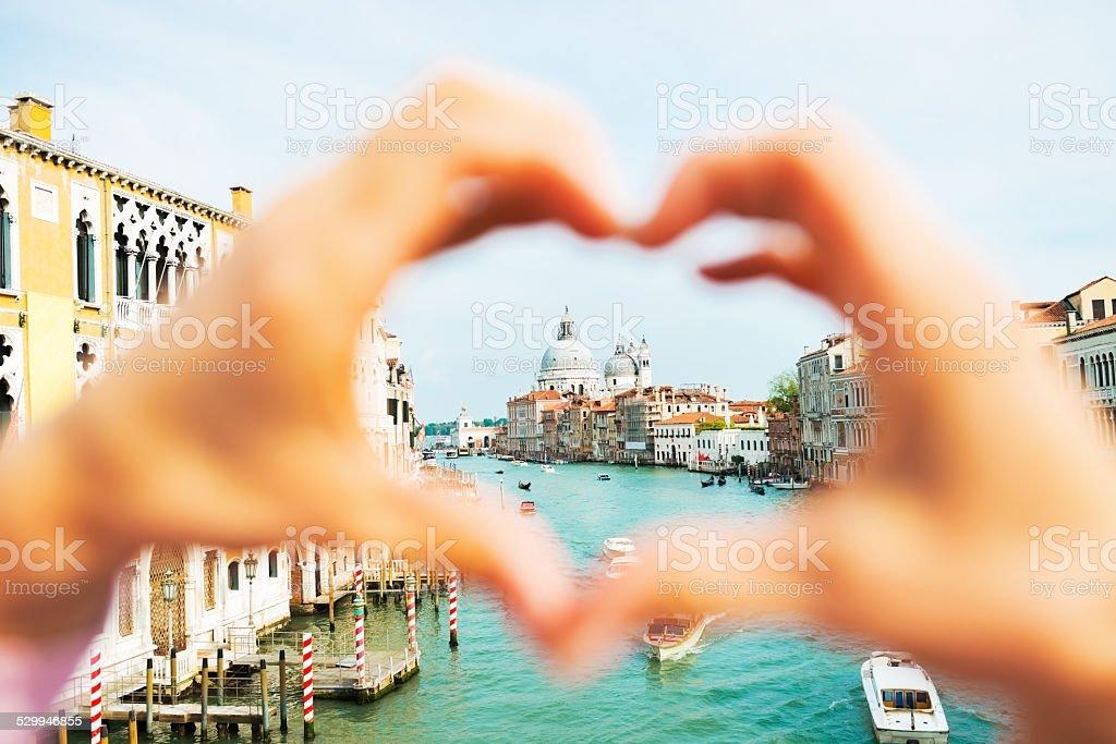Santa maria della salute venice, framed by heart shaped hands stock photo