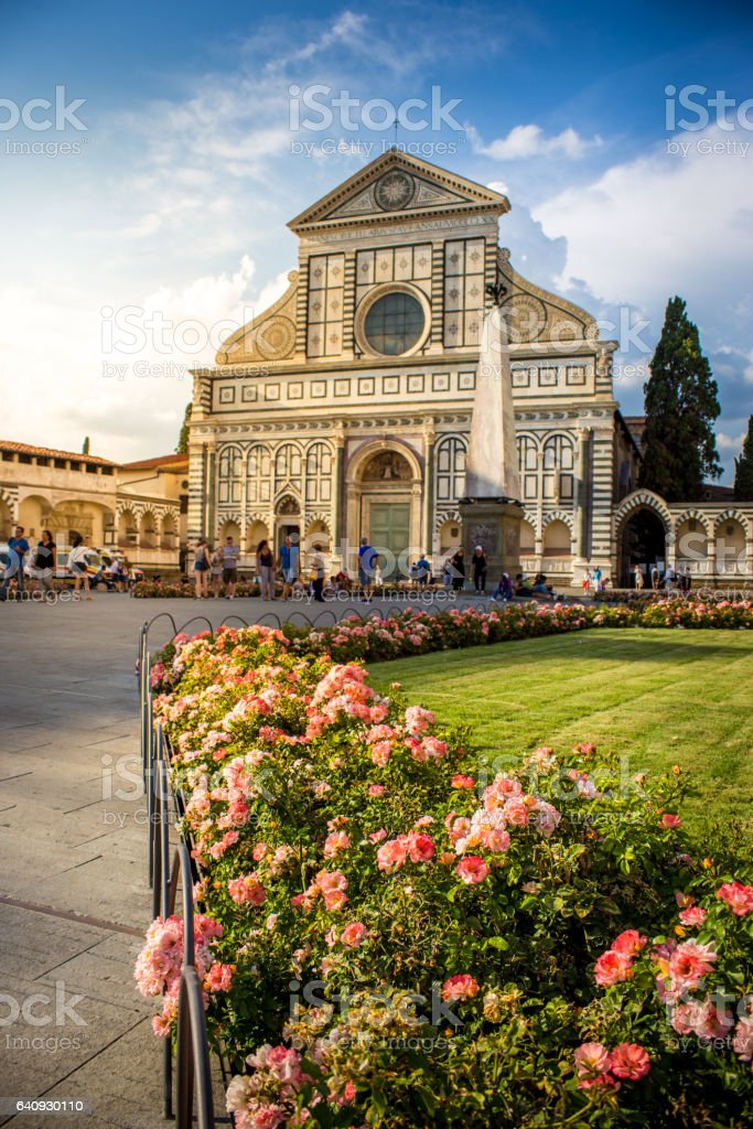 Santa Maria Novella in pink flowers in a summer day. Florence, Italy stock photo
