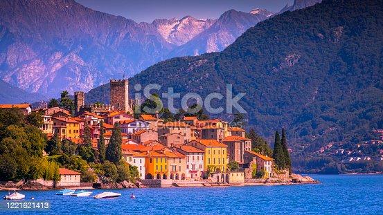 Santa Maria Rezzonico jetty habor with boats on Lake Como and Alpine landscape - Lombardy, Italy