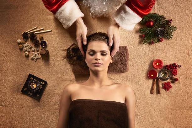 Santa masseur make SPA treatment for young beautiful woman. stock photo