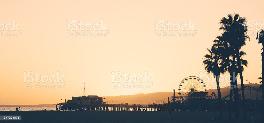Santa Monica beach and pier at sunset stock photo