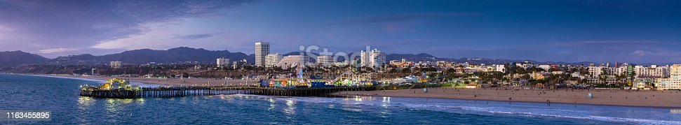 Aerial panorama of the beach and pier of Santa Monica, California from out over the ocean.