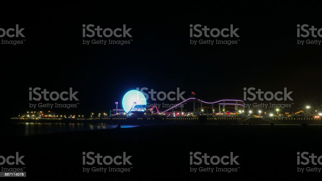 Santa Monica Pier, Los Angeles at night 4k stock photo