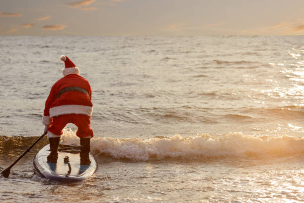santa on sup board - vintage nautical stock photos and pictures