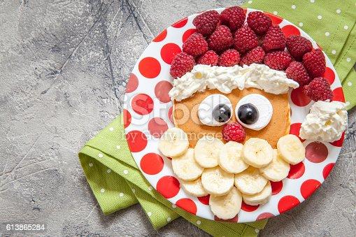 istock Santa pancake with raspberry for kid breakfast 613865284