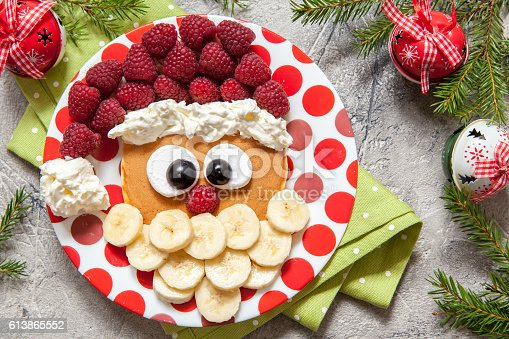 istock Santa pancake with raspberry for kid breakfast 613865552