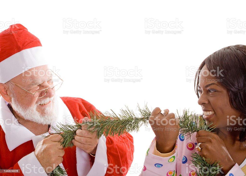 Santa Playing  Tug of War Young Woman Christmas Garland Isolated royalty-free stock photo