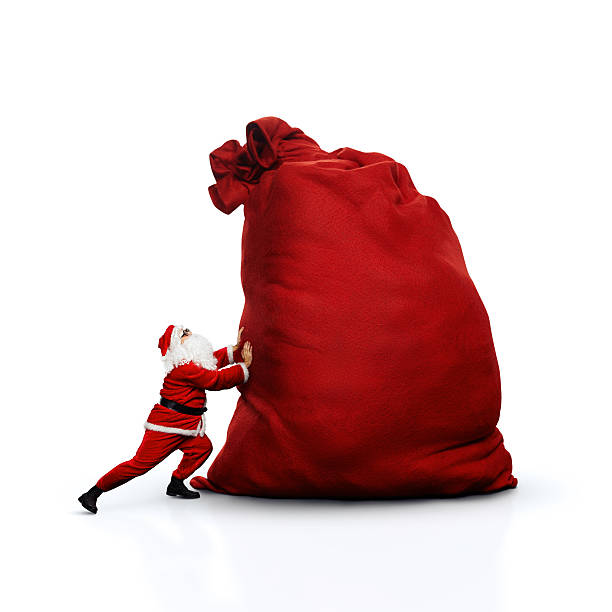 Santa pushing huge sack. Isolated on white. stock photo