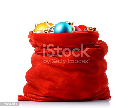 istock Santa red bag with christmas toys, isolated path included 626541890