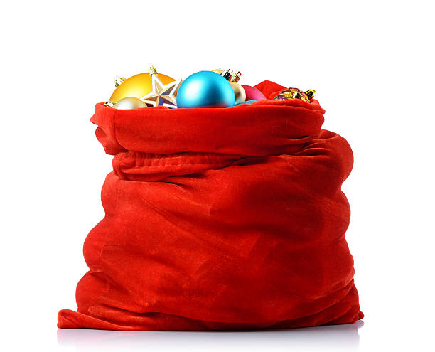 santa red bag with christmas toys, isolated path included - sack stock pictures, royalty-free photos & images