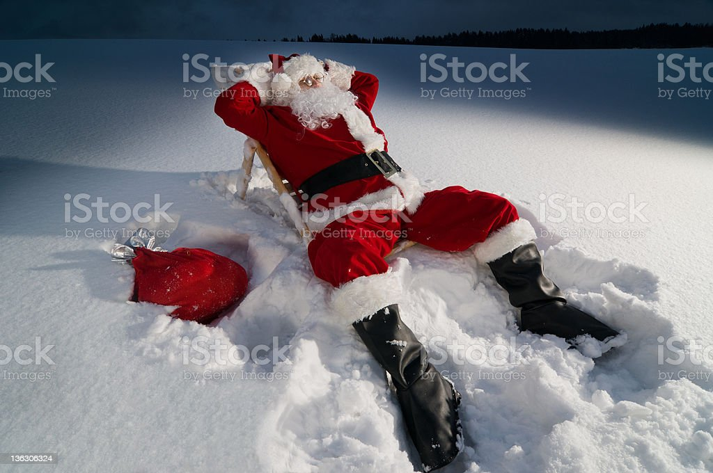 Santa relaxing on a sunbed royalty-free stock photo
