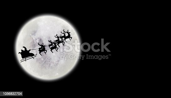 Santa riding sleigh with reindeers silhouette