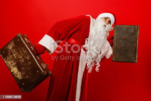 Santa: Santa With Gift and Luggage Going On A Trip