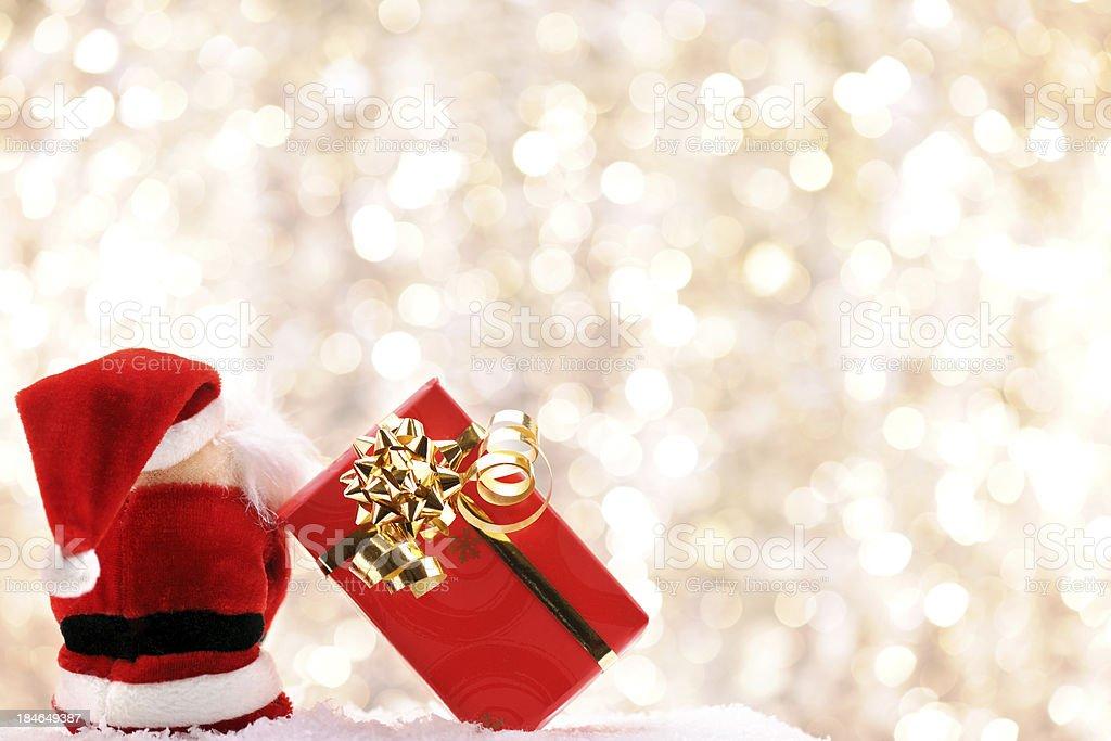 Santa sitting with his christmas present royalty-free stock photo