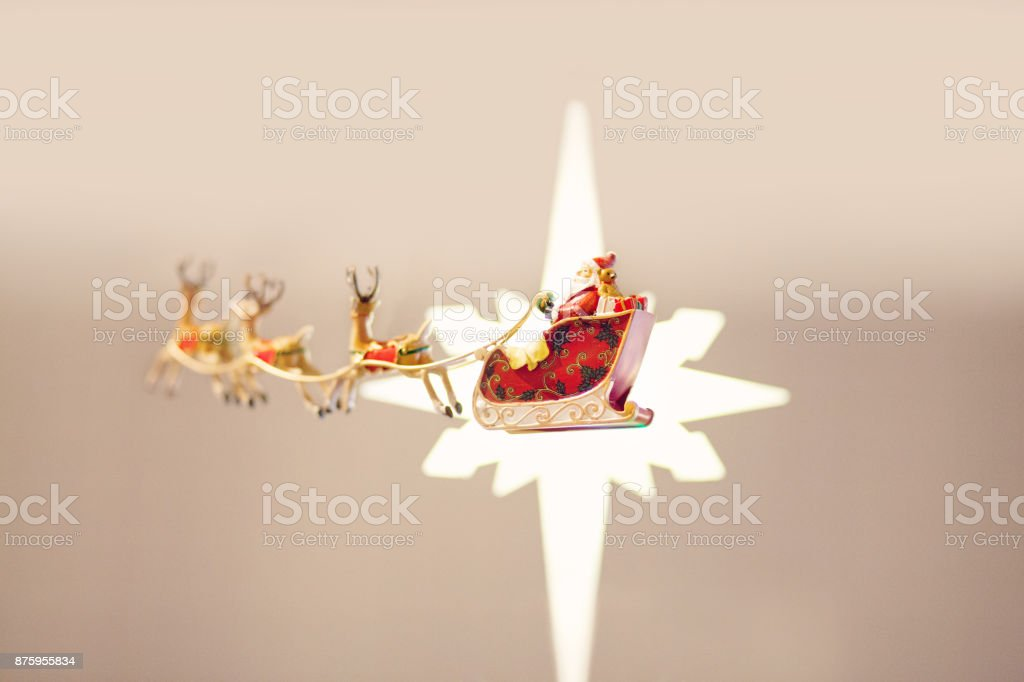 Santa Sled and Reindeer Flying in front of a Star stock photo