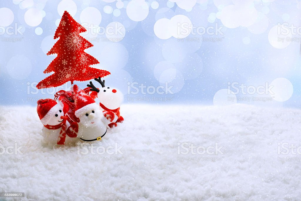 Santa Snowman And Deer Toys Under A Christmas Tree Stock Photo Istock