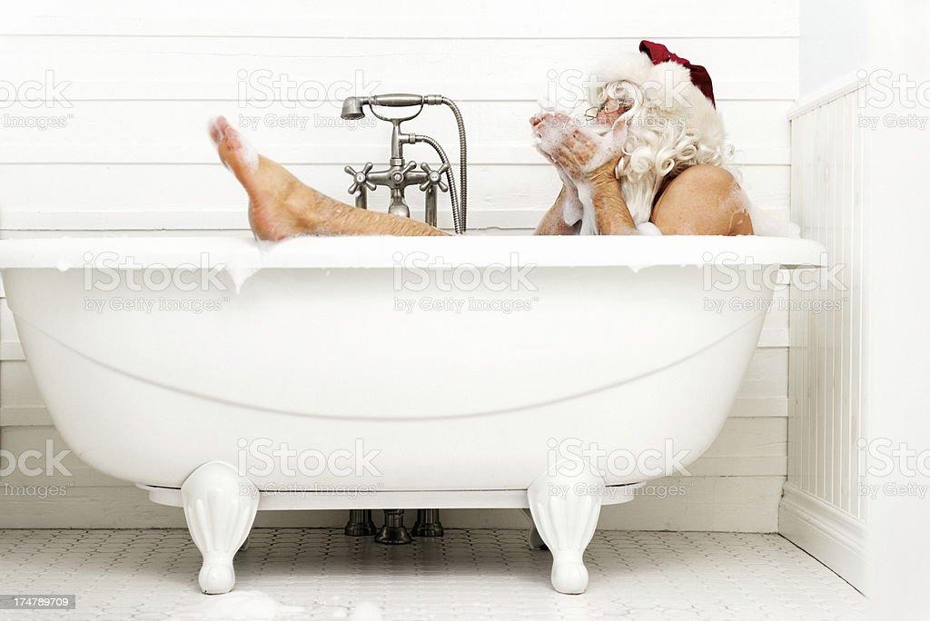 Santa taking a bath royalty-free stock photo