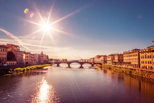 Santa Trinita Bridge on Arno river, sunset landscape. Florence, Tuscany, Italy , Europe