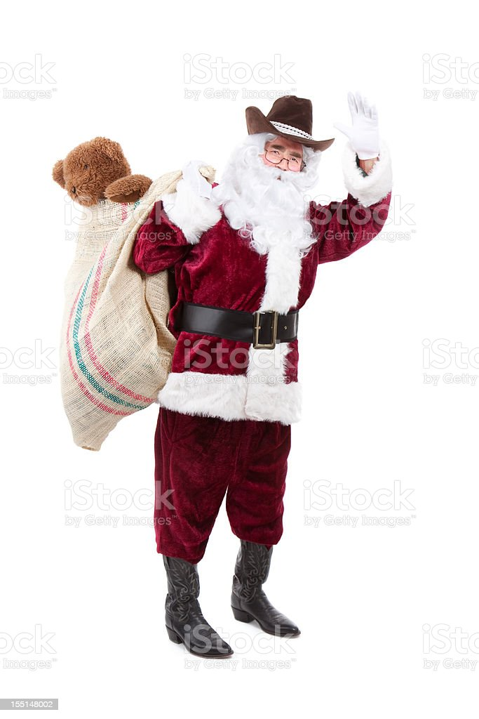 Santa Wearing Cowboy Hat and Boots with Burlap Toy Sack royalty-free stock photo