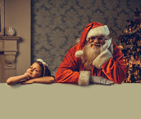 istock Santa with blank empty white poster 1067409050