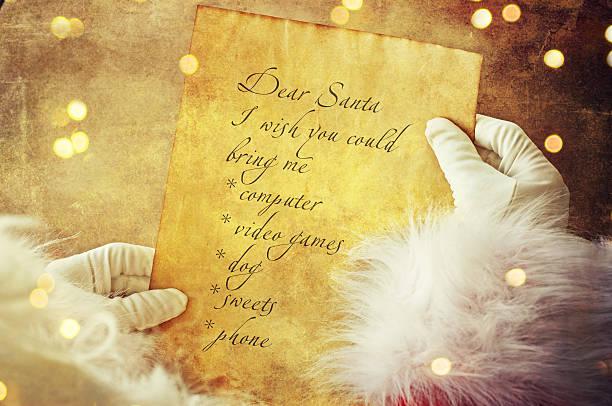 santa with christmas letter or wish list - weihnachts wunschliste stock-fotos und bilder
