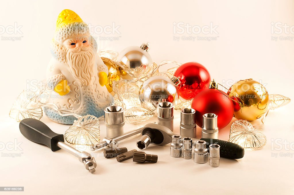 Santa with christmas toys spanner-torx and screwdriver stock photo