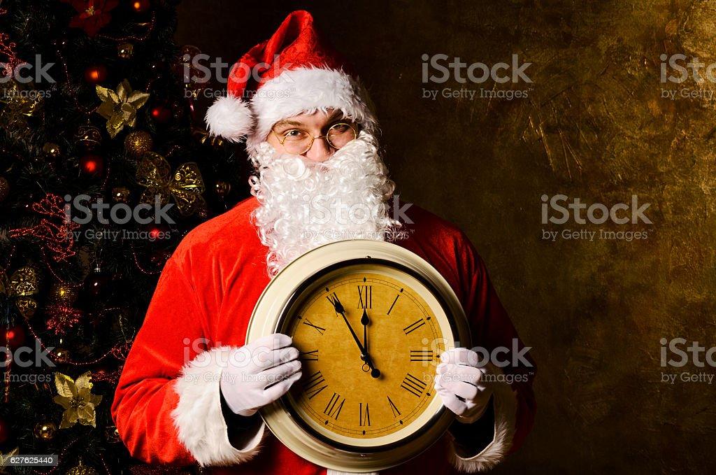 Santa with clock stock photo