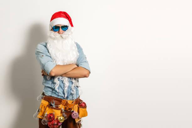 Santa with construction tools, santa repairman stock photo