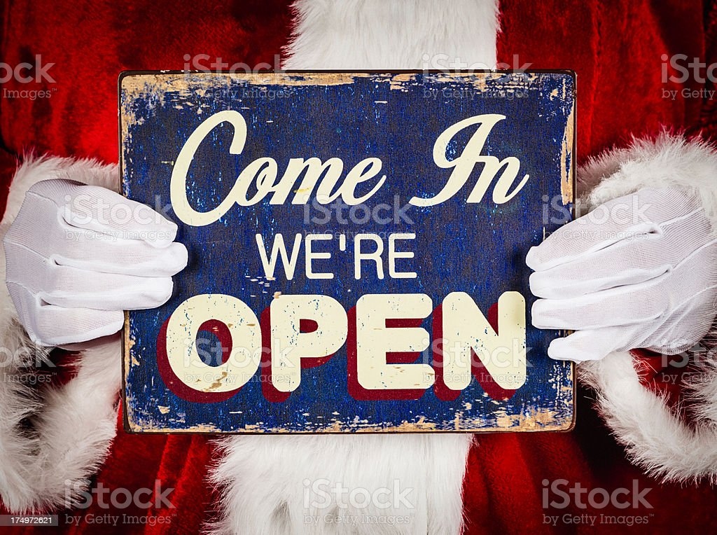 Santa with Open Sign stock photo