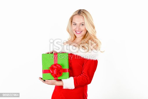 Young woman in Santa suit giving gift, close-up, portrait, white background