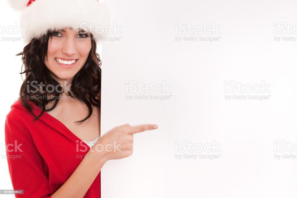 Femme de Santa pointant sur bannière vierge photo libre de droits