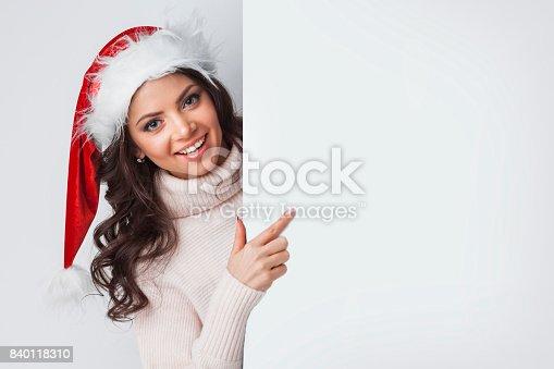 istock Santa woman pointing at blank whiteboard 840118310
