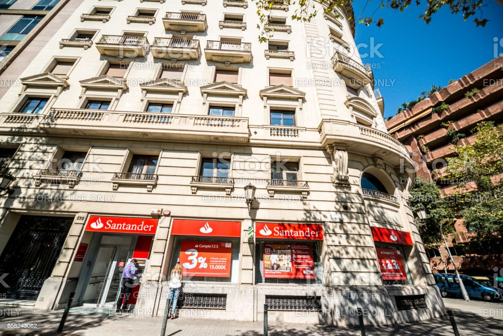 Santander Bank With People Using Atm In Barcelona Spain