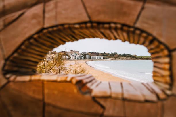 Santander, Spain Sardinero beach in Santander, Spain, as seen from a wall on Piquio gardens santander spain stock pictures, royalty-free photos & images