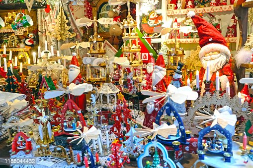 Colmar, France, December 16, 2016: Santas and small and cute new year gifts, christmas markets christmas gifts and christmas decorations, meet and celebrate the new year in a dreamy city, merry christmas