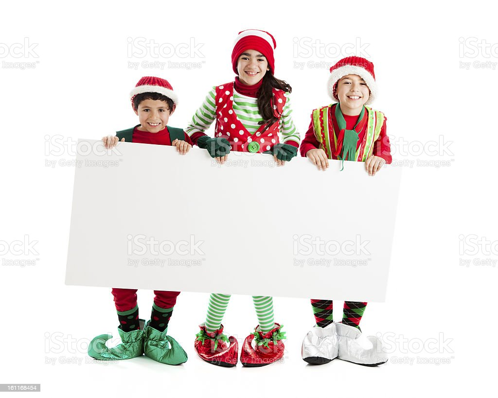 Santas Christmas Elves Hold a Blank Sign for Advertising Message stock photo