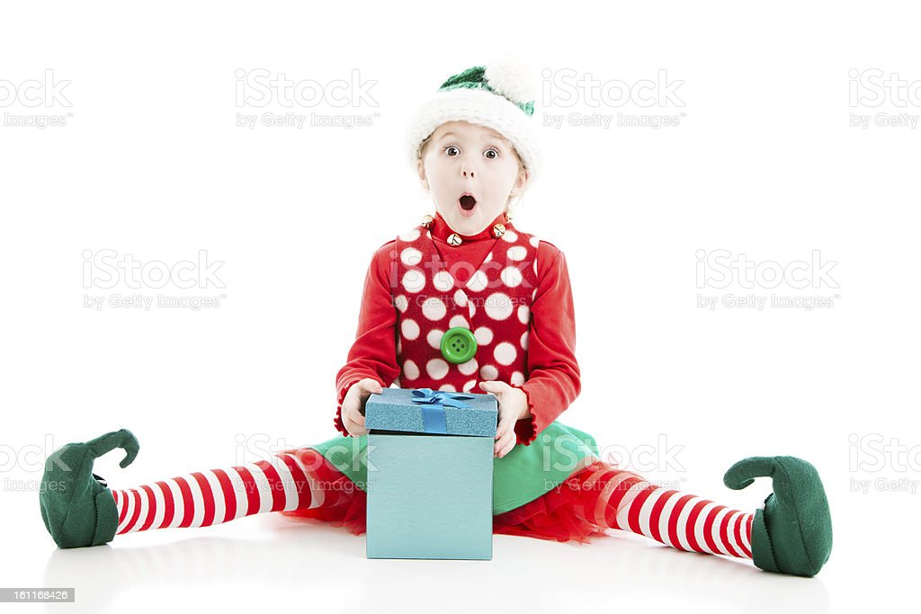 Santas Elf is Surprised Opening Christmas Present stock photo