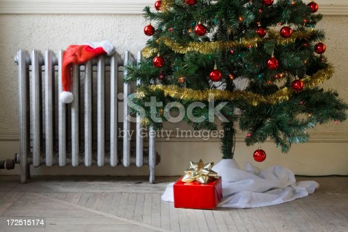 Artificial christmas tree in  dirty room with gift and Santa HatRelated images: