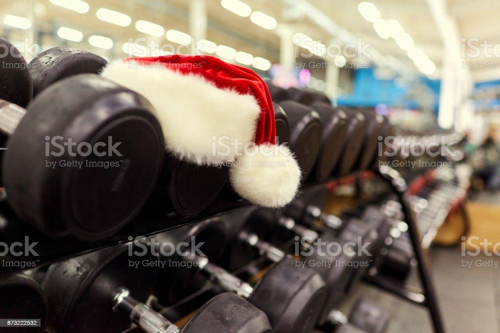 Santa's hat in the gym. stock photo