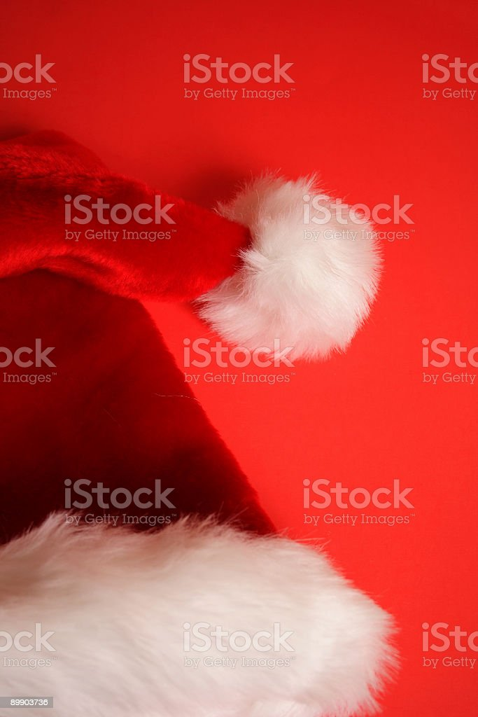 Santa's Hat on red Background royalty free stockfoto