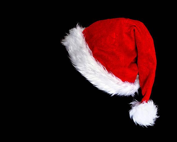 santa's hat santa's hat over black background santa hat stock pictures, royalty-free photos & images