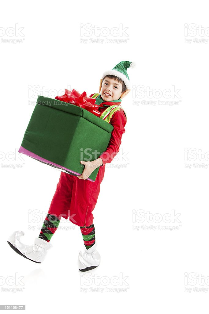 Santas Helper Elf Struggles with Big Heavy Christmas present. stock photo