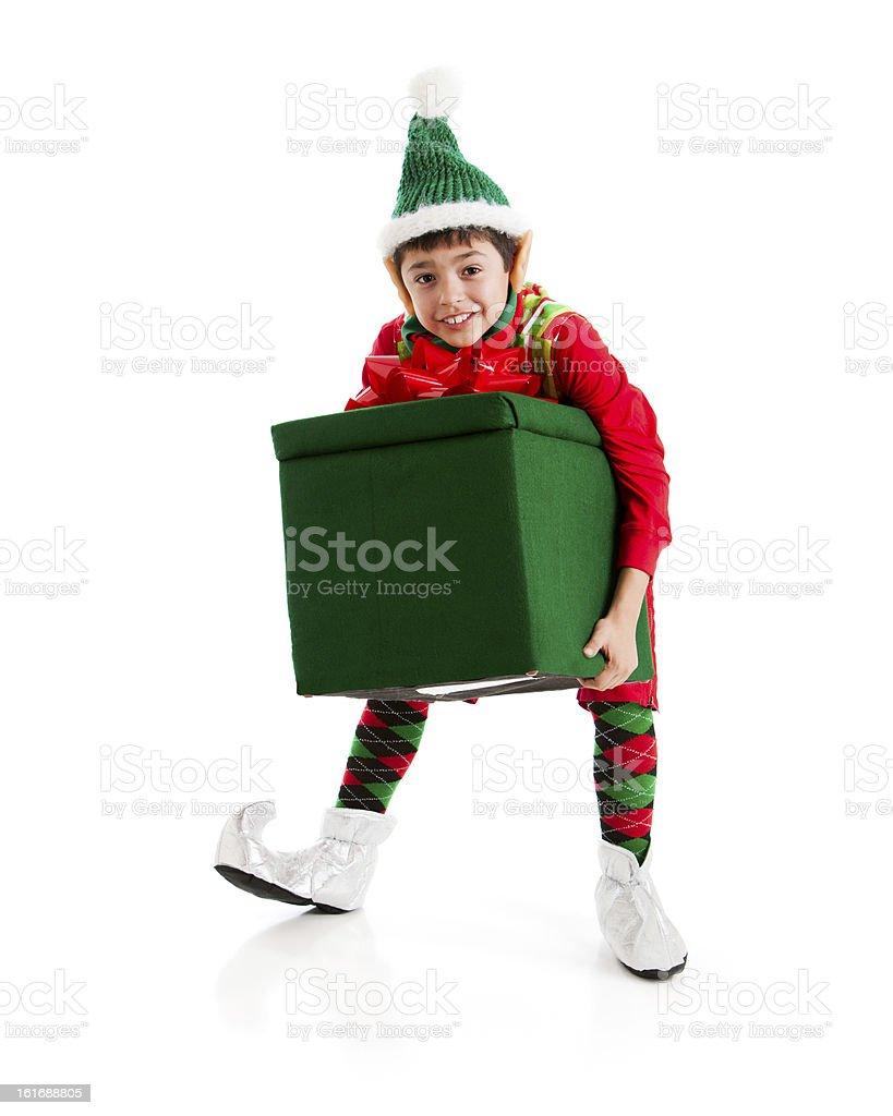 Santas Helper Elf Struggles with Big Heavy Christmas present. royalty-free stock photo