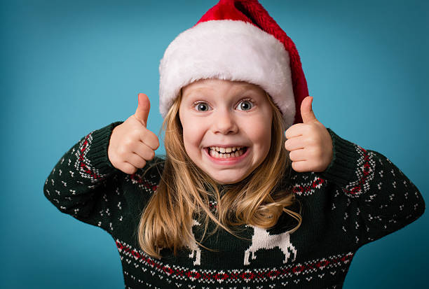 santa's little helper giving thumbs up sign - ugly girl stock photos and pictures