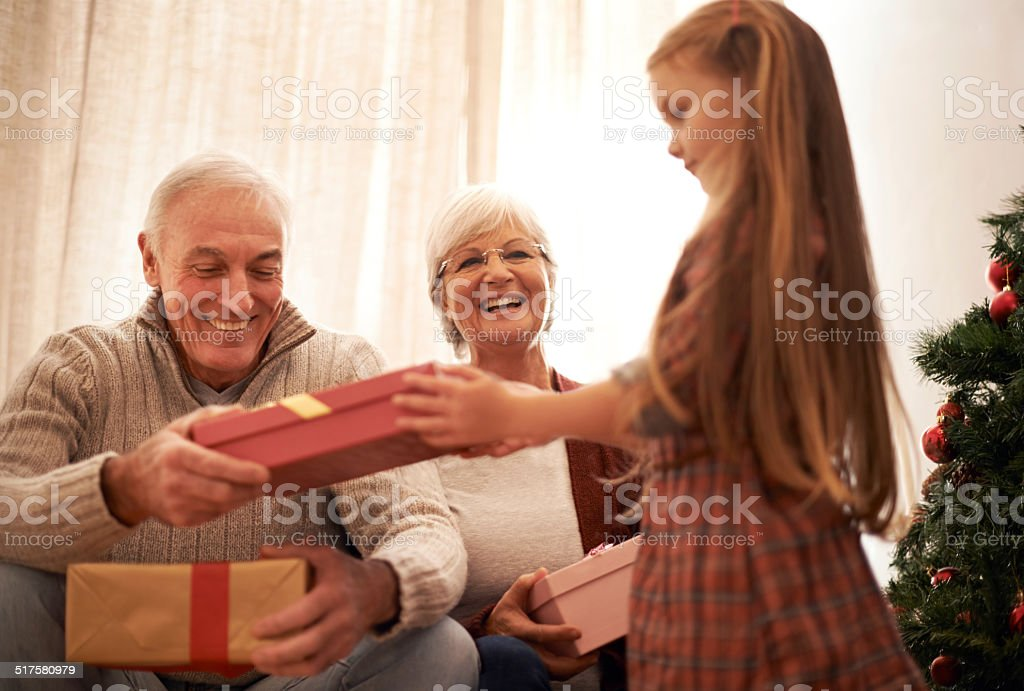 Santa's little helper is bringing in the gifts stock photo