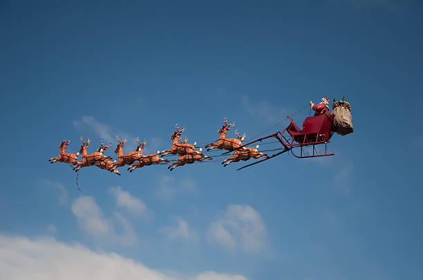 Santa's Sleigh Santa's Sleigh flying above the city during Christmas sled stock pictures, royalty-free photos & images