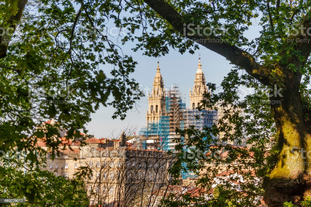 Santiagro de Compostela cathedral from oak forest stock photo