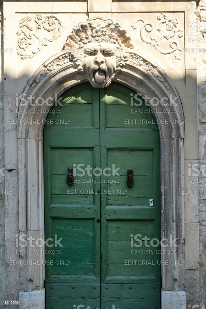 Sant'Ippolito (Fossombrone, Marches): door of historic palace stock photo